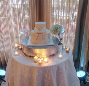 The Wedding Cake Looks Beautiful With Uplighting.